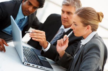 Group Looking at Computer