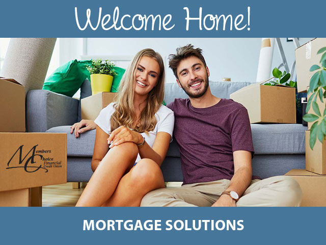 mortgage solutions. couple smiling on couch