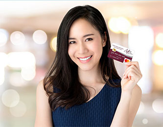 Woman Smiling with card