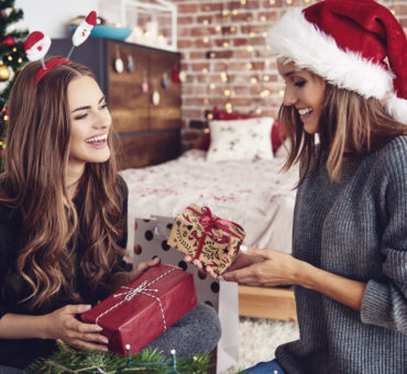 Friends exchanging gifts