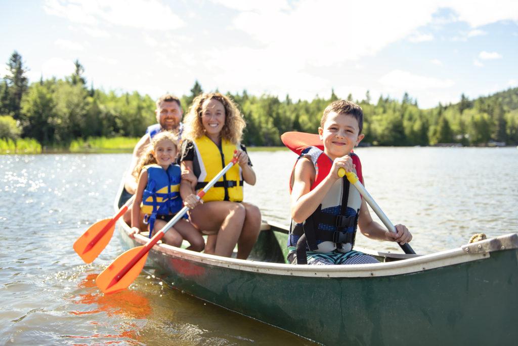 A Family in a Canoe on a Lake having fun